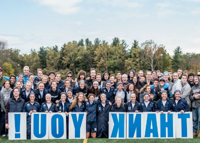 Women's sports team with Thank You sign.
